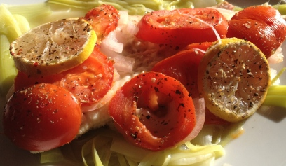Papillote fish with tomatoes and leek tagliatelle